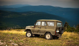 Adventure in the mountains. A jeep parked on a mountain top in Karkonosze Mountains royalty free stock photography