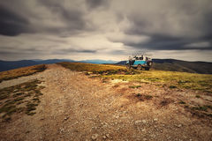 Adventure in the mountains, off road in an SUV. Royalty Free Stock Photo
