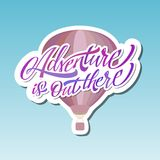 Adventure is out there. Hot Air Baloon. Lettering. Sticker. Adventure is out there. Hot Air Baloon. Modern Lettering. Sticker Stock Photo