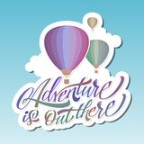 Adventure is out there. Hot Air Baloon. Lettering. Sticker. Adventure is out there. Hot Air Baloon. Modern Lettering. Sticker Royalty Free Stock Image
