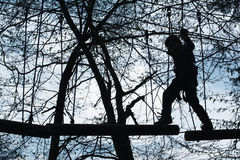 Adventure park. Child in adventure park walking on tree logs Stock Photography