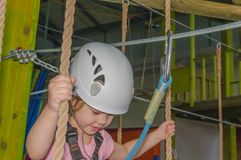 In the adventure Park the kid in the white helmet, close-up Royalty Free Stock Image