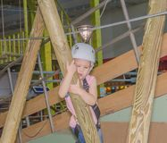 In the adventure Park the kid in the white helmet was frightene Royalty Free Stock Photos