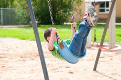 Adventure on the park swing Stock Photos