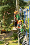 Climbing visitors in adventure park Royalty Free Stock Photography