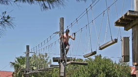 Adventure park, the young man performs. stock footage