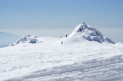 Adventure. People in winter mountain Stock Images