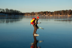 Adventure skating. A woman skating in the Stockholm archipelago, Sweden Royalty Free Stock Images