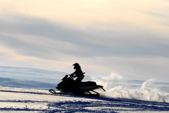 Adventure on snowmobile. Man alone on snowmobile in untouched nature in Finnmark, Norway Stock Photos