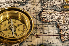 Adventure still life. With retro navy compass and map Stock Photography