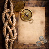 Adventure stories background. (old compass, coins, rope and paper Royalty Free Stock Image