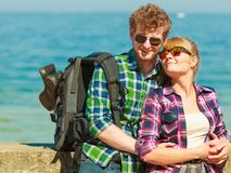 Couple backpacker tramping by seaside. Adventure, summer, tourism active lifestyle. Young couple backpacker tramping by seaside Royalty Free Stock Photography