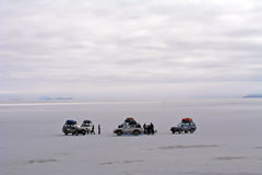Adventure team. Tree cars from an adventure team in the salar Uyuni, Bolivia. Far horizon Stock Images