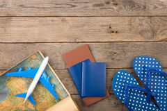 Adventure time concept - plane, map, passport on the wooden desk Royalty Free Stock Image
