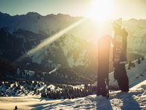 Adventure to winter mountain. Snowboarder girl. On the background of high season deep fresh snow, Alps in Switzerland Stock Photography