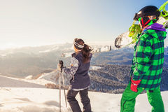 Adventure to winter sport. Skier and snowboarder hiking at mountain Stock Images