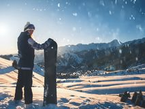 Adventure to winter sport. Snowboarder girl on background high mountain stock image