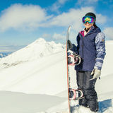 Adventure to winter sport. Snowboarder girl Royalty Free Stock Image