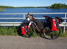 Adventure touring bike by lake Saimaa on summer evening. Lappeenranta, Finland – June 29, 2015: Adventure bike with mountain bike & touring bike stock images