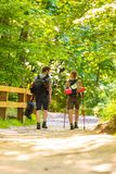 Couple backpacker hiking in forest pathway stock photography