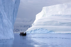 Adventure tourists - Scoresbysund - Greenland. Adventure tourists and Icebergs in Scoresbysund in eastern Greenland Stock Image