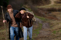 Adventure travel. Rural couple goes on road Stock Image