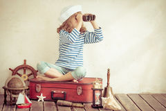 Adventure and travel concept. Happy child playing with vintage nautical things. Kid having fun at home. Summer sea dream and imagination. Adventure and travel Royalty Free Stock Photos