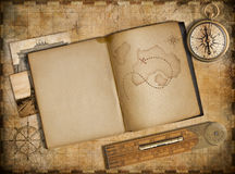 Adventure and travel concept. Vintage map, copybook and compass. Royalty Free Stock Photography