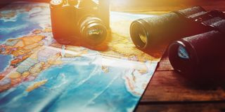 Adventure Travel Scout Journey Concept. Black Film Camera, Map And Binoculars On Wooden Table, Panoramic View. Vintage Black Film Camera, Map And Binoculars On Royalty Free Stock Photography