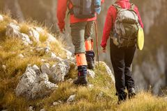 Adventure, travel, tourism, hike and people concept - smiling couple walking with backpacks outdoors.  royalty free stock images