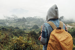 Adventure travel woman with a backpack in the mountains during a Stock Photography