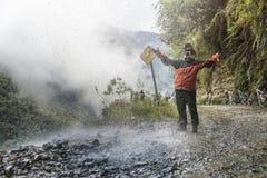 Adventure traveler enjoys waterfall Royalty Free Stock Image