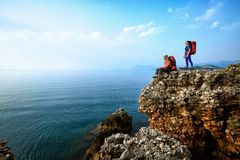 Adventure trek along the coast with a backpack in the summer. Hike along the coast of the Mediterranean Sea with a backpack and tent royalty free stock photography