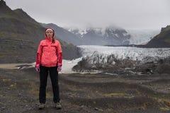 Adventure woman by glacier nature on Iceland. Vatna glacier, Vatnajokull National Park. Young woman visiting nature landscape royalty free stock image