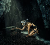 Adventure. Woman opens a treasure chest. Adventure. Woman treasure hunter opens a treasure chest in the secret cave Royalty Free Stock Images