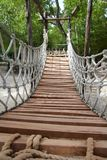 Adventure wooden rope jungle suspension bridge Stock Photo