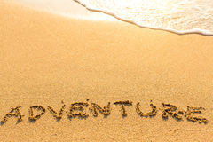 Adventure - word drawn on the sand beach Royalty Free Stock Photography