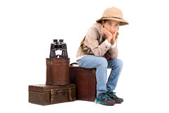 Adventure. Young boy with suitcases playing Safari isolated in white Royalty Free Stock Image