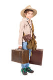 Adventure. Young boy with suitcases playing Safari isolated in white Stock Image
