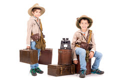 Adventure. Young boys with suitcases playing Safari isolated in white Royalty Free Stock Image