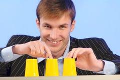 Adventurer, bad bank. Businessman plays bad financial business - constructed on deceit, bad bank stock image