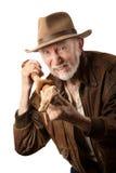 Adventurer or archaeologist defending himself Royalty Free Stock Photos