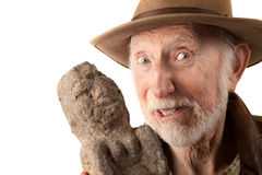 Adventurer or archaeologist with idol Royalty Free Stock Image