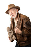 Adventurer or archaeologist offering to sell idol. Adventurer or archaeologist in brown leather jacket offering to sell  idol Stock Image