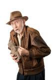 Adventurer or archaeologist with stolen idol. Adventurer or archaeologist in brown leather jacket with stolen idol Stock Photos
