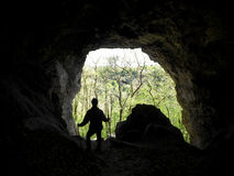 Adventurer in the cave. Tourist adventurer in the cave, the Caucasus foothills, Adygea, Russia Royalty Free Stock Photos