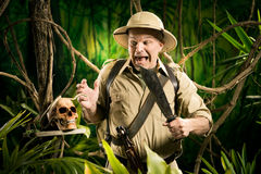 Adventurer finding a skull Royalty Free Stock Image