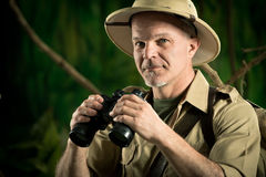 Adventurer in the jungle with binoculars Royalty Free Stock Image