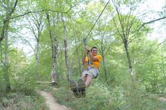 Adventurer man going on zip line Royalty Free Stock Images