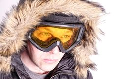 An adventurer / skier / snowboarder with ski goggles stock photo